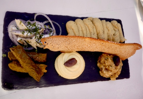 fresh sardines, domas, eggplant dip, hummus and mystery mayo-ey cheesey dip